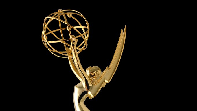 Close cropped photograph of an Emmy award trophy.