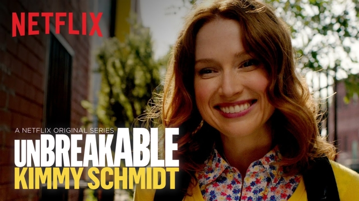 Promo still for The Unbreakable Kimmy Schmidt showing a woman smiling.
