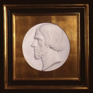 Marble medallion portrait of John Gibson by Harriet Hosmer, 1866.